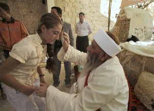 Worshipper blessed by a Yazidi Priest at Lalish Temple.